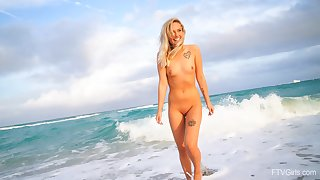 Cute blonde Winter drops her overheated raiment to tease in in sight