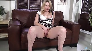 Chubby blonde Mel Harper loves fingering the brush pussy on the sofa