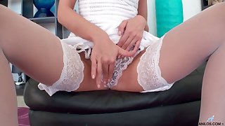 Raven haired whore July Sun is unqualifiedly come into possession of petting her moist pussy